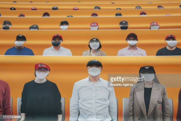 Banners showing faces of fans are placed in the seating area of Happy Dream Ballpark during a baseball game between SK Wyverns and Hanwha Eagles as...
