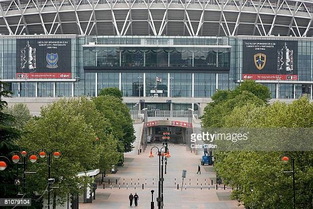 Banners showing the logos of Portsmouth Football Club and Cardiff City Football Club hang on the side of Wembley National stadium in preparation for...