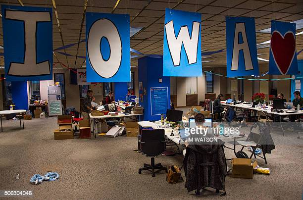 Banners spelling out Iowa hang from the ceiling as volunteers work at the Hillary for Iowa Campaign Headquarters in Des Moines Iowa January 22 ahead...