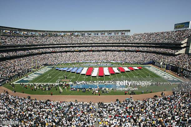 Banners symbolic of the American flag are unfurled on the field before the game between the San Diego Chargers and the Dallas Cowboys on September 11...