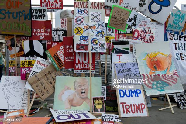 Banners used during the protest were left by protesters leaning against security fences Thousands of protesters marched in central London against...