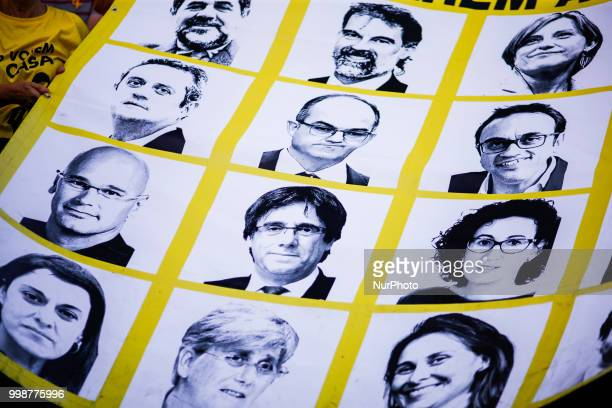 Banners with catalan political prisoners and exiled during the demonstration of Independence political parties and independence assosiations against...