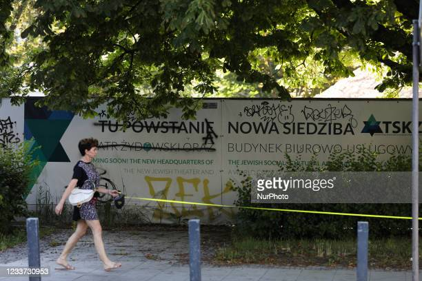 Banners with grafitti are seen at a construction site in a former Jewish neighbourhood on 29 June, 2021 in Warsaw, Poland. The Polish government has...