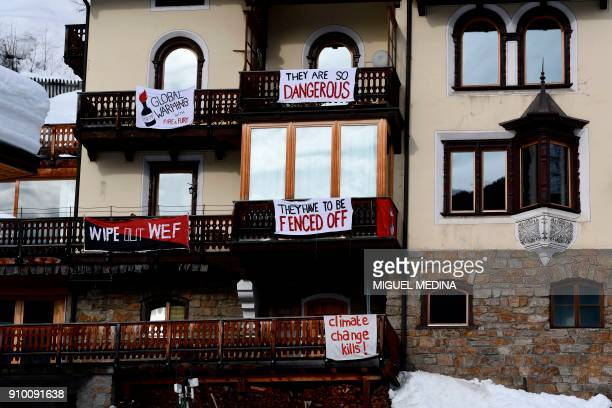 TOPSHOT Banners with the letterings 'They are so dangerous' 'Global warming with fire and fury' and 'They have to be fenced off' are attached to the...