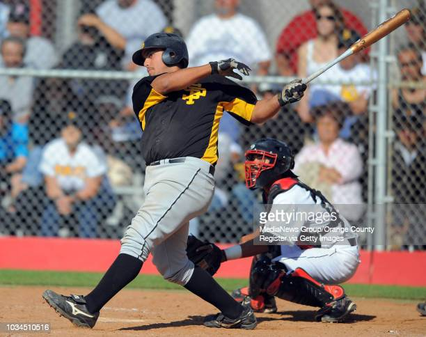 Banning beat San Pedro 6-5 to win the Marine League baseball title. San Pedro's Christopher Costa connects for a 3-run RBI single in the 5th inning...