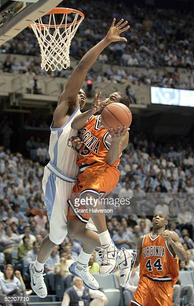J Bannister of the Virginia Cavaliers drives to the basket against Rashad McCants of the North Carolina Tar Heels during an Atlantic Coast Conference...