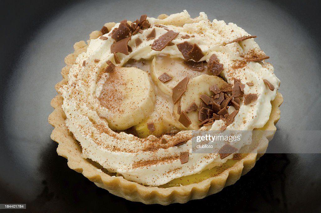 Banoffee pie on a black serving dish : Stock Photo