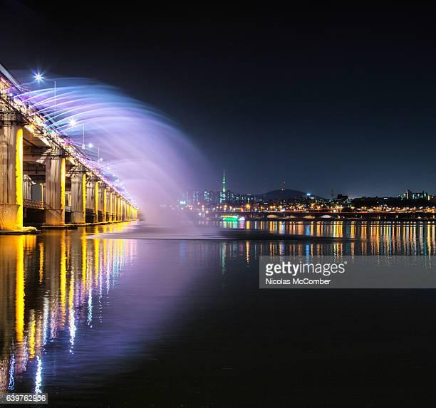 Banpo bridge water and light show with Seoul skyline