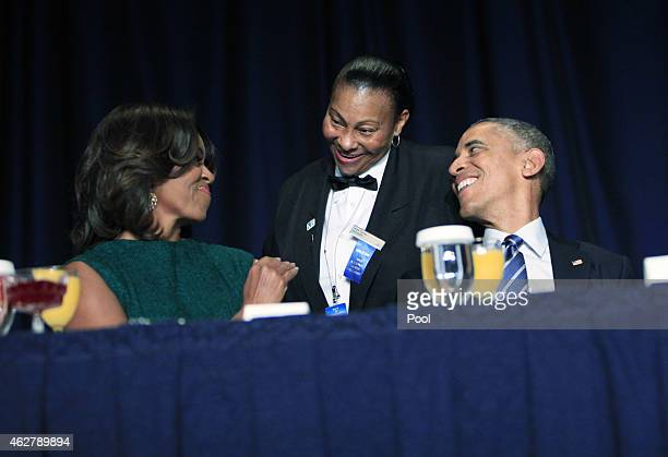 Banquet server Kitty Casey serves first lady Michelle Obama and US President Barack Obama during the National Prayer Breakfast February 5 2015 in...