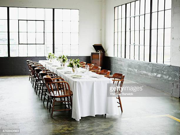 Banquet table set for dinner in loft