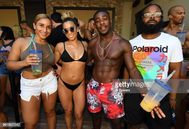 UFC bantamweight Aljamain Sterling poses for photos with fans during a UFC Pool Party on July 4 2018 at the Hard Rock Hotel Casino in Las Vegas Nevada