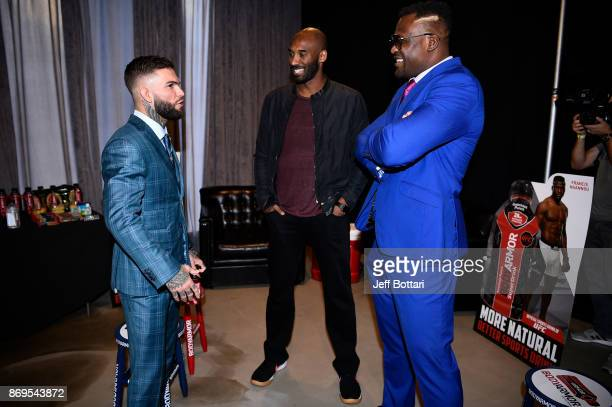 UFC Bantamweight Champion Cody Garbandt BodyArmor investor Kobe Bryant and UFC heavyweight Francis Ngannou interact backstage during the UFC...