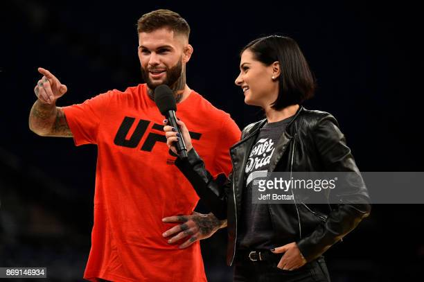 Bantamweight Champion Cody Garbrandt and UFC host Megan Olivi interact with fans and media inside Madison Square Garden on November 1, 2017 in New...