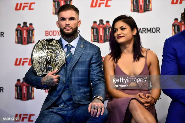 Bantamweight Champion Cody Garbrandt and UFC strawweight Cynthia Calvillo sit onstage during the UFC BodyArmor partnership announcement inside...