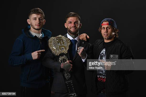 UFC bantamweight champion Cody Garbrandt poses with Urijah Faber and Chris Holdsworth backstage during the UFC 207 event at TMobile Arena on December...