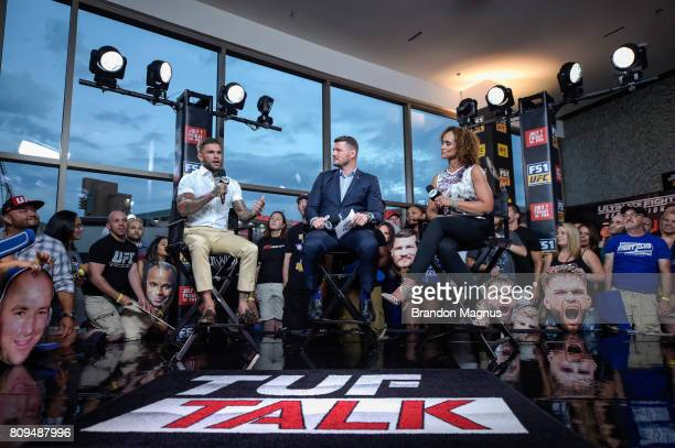 UFC bantamweight champion Cody Garbrandt speaks with UFC middleweight champion Michael Bisping and Karyn Bryant during TUF Talk at Park Theater on...