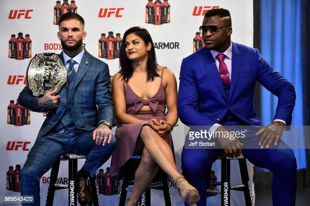 UFC Bantamweight Champion Cody Garbrandt UFC strawweight Cynthia Calvillo and UFC heavyweight Francis Ngannou sit onstage during the UFC BodyArmor...