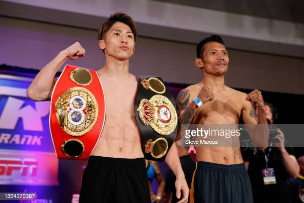 Bantamweight champion Naoya Inoue of Japan poses with Michael Dasmarinas of Philippines during an official weigh-in at Virgin Hotels Las Vegas on...