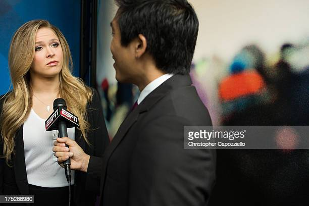 Bantamweight champion Ronda Rousey is interviewed by ESPN.com anchor Cary Chow at ESPN's headquarters August 1 in Bristol, Connecticut. Rousey will...