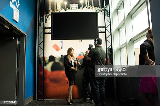 UFC bantamweight champion Ronda Rousey is interviewed by ESPNcom anchor Cary Chow at ESPN's headquarters August 1 in Bristol Connecticut Rousey will...