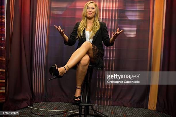UFC bantamweight champion Ronda Rousey is interviewed on the Dan Lebatard Show for ESPN2 at ESPN's headquarters August 1 2013 in Bristol Connecticut...