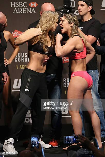 UFC Bantamweight Champion Ronda Rousey of the United States and Bethe Correia of Brazil face off during their UFC 190 weighin at HSBC Arena on July...