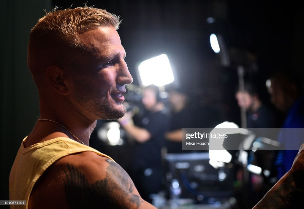 UFC bantamweight champion TJ Dillashaw interacts with media backstage during the UFC 227 weigh-in inside the Orpheum Theater on August 3, 2018 in Los Angeles, California.