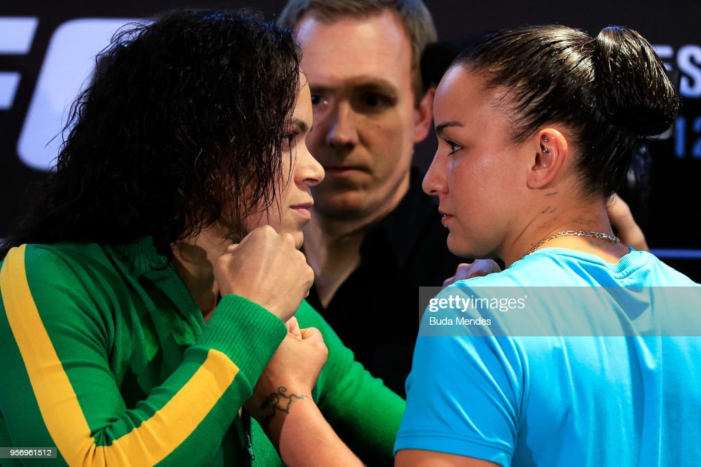 UFC bantamweight fighters Amanda Nunes (L) of Brazil and Raquel Pennington of the United States face off during Ultimate Media Day on May 10, 2018 in Rio de Janeiro, Brazil.