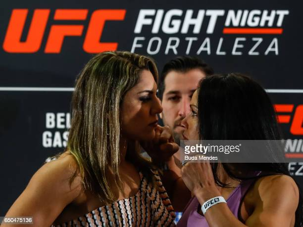 Bantamweight fighters Bethe Correia of Brazil and Marion Reneau of the United States face off during Ultimate Media Day at Gran Marquise Hotel on...