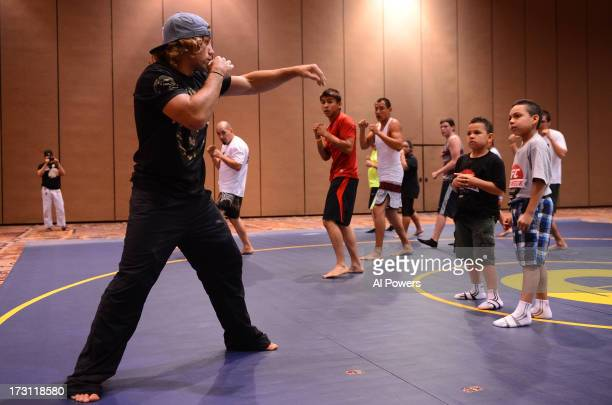 UFC bantamweight Urijah Faber teaches a seminar during the UFC Fan Expo Las Vegas 2013 at the Mandalay Bay Convention Center on July 6 2013 in Las...