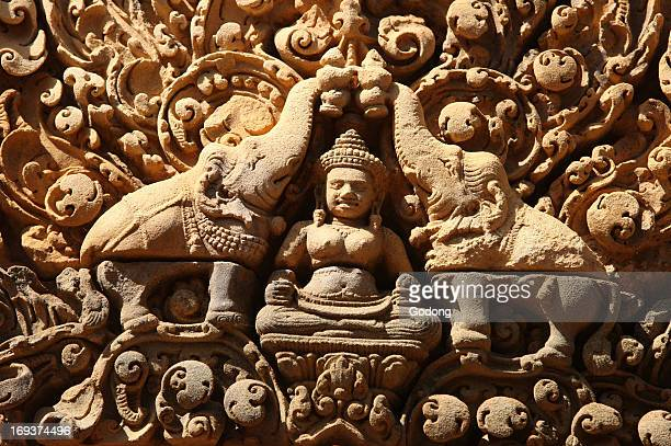 Banteay Srei Temple at Angkor in Cambodia Lakshmi Hindu goddess of wealth and wife of god Vishnu is sprinkled with holy water by two elephants