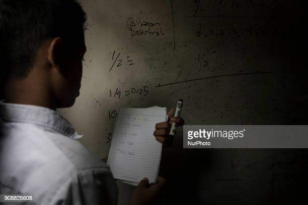 A student learning mathematics deciimal number concept during the class Primary School Bantar Panjang located at Dahu VillageSerang almost collapse...