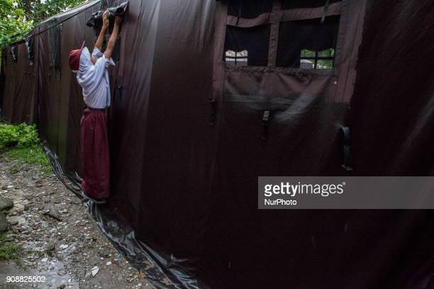 A student open the tent window to give light coming in for the class Primary School Bantar Panjang located at Dahu VillageSerang almost collapse and...