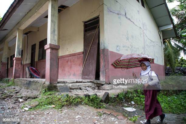 A student with the damagede building school in the background Primary School Bantar Panjang located at Dahu VillageSerang almost collapse and without...