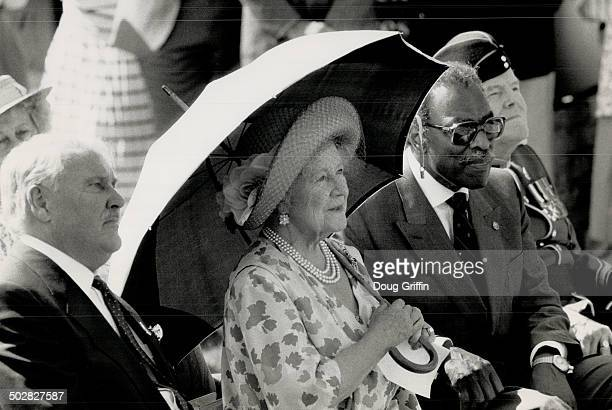 Banting tribute The Queen Mother shelters from the sun with LieutenantGovernor Lincoln Alexander at a ceremony honoring Frederick Banting insulin...