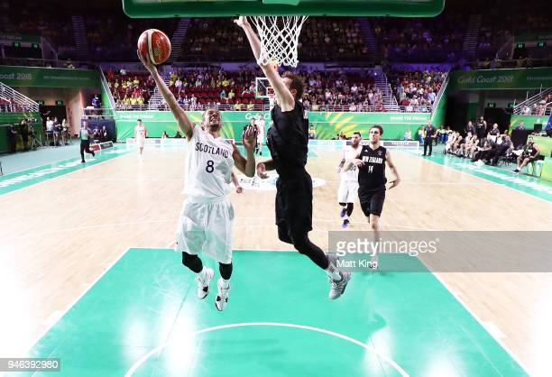 Bantu Burroughs of Scotland drives to the basket during the Men's Bronze Medal Basketball Game between Scotland and New Zealand on day 11 of the Gold...