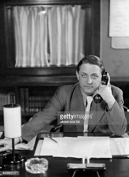 Bantz Elmer Radio announcer*sitting at a desk an using a telephone Photographer Ullmann Published by 'Hier Berlin' 37/1939Vintage property of...