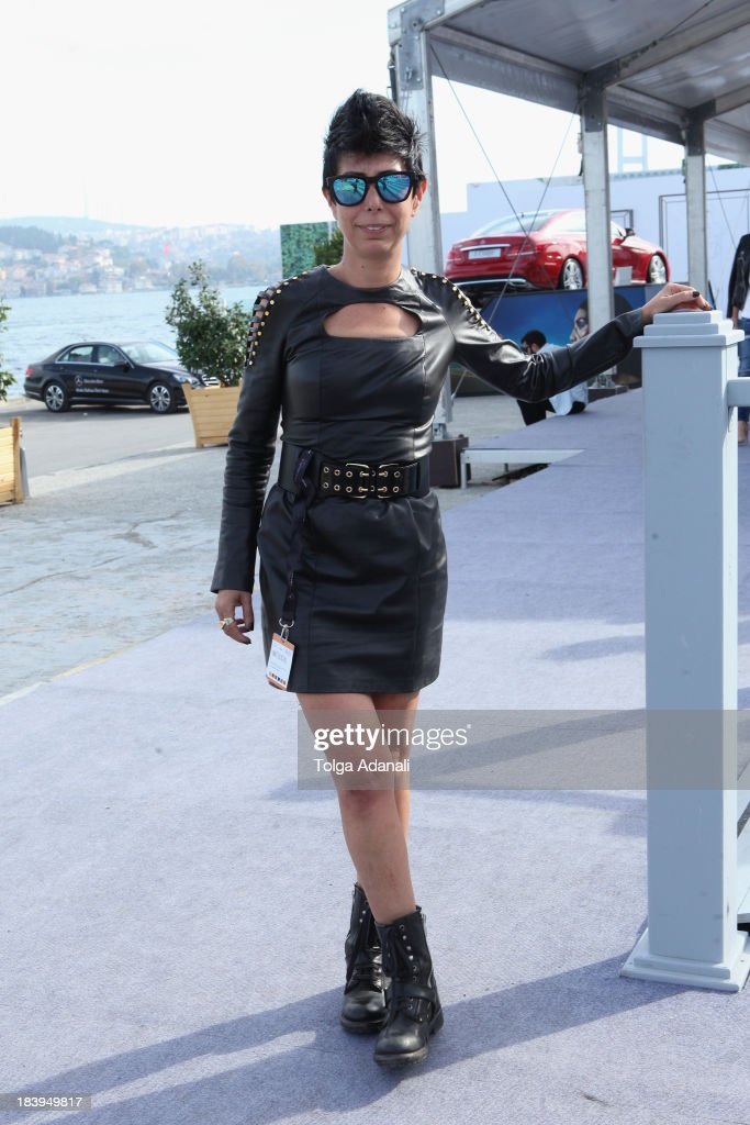 Banu Bolen wears a Zeynep Tosun dress during Mercedes-Benz Fashion Week Istanbul s/s 2014 presented by American Express on October 10, 2013 in Istanbul, Turkey.