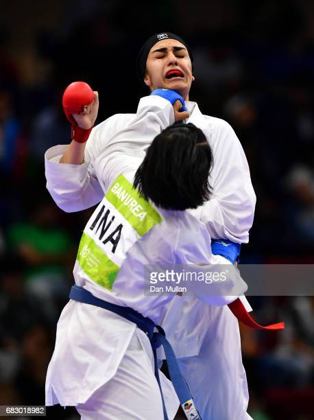 Banurea Dessyinta of Indonesia competes against Aghaei Mohadaseh of Iran in the Womens Karata Kumite 68kg bronze medal match during day three of Baku...