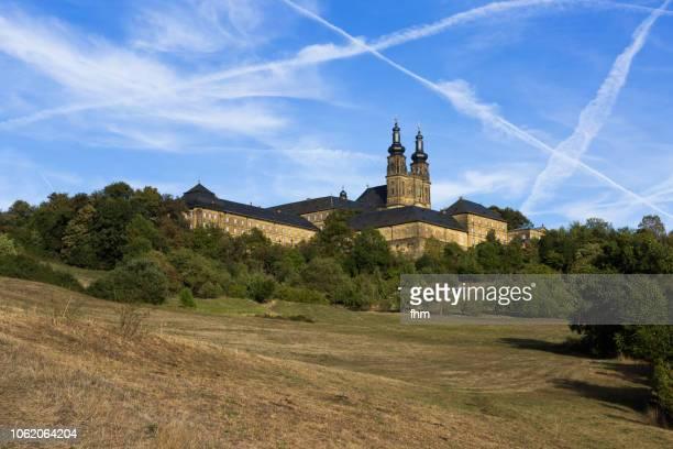 banz abbey with chemtrails (upper franconia, bavaria/ germany) - chemtrails stock-fotos und bilder