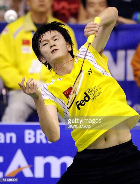 Bao Chunlai of China hits a smash against Lee Hyun-il of South Korea during their final match at the Thomas Cup badminton tournament in Jakarta on...