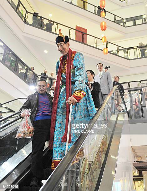 Bao Xishun of China, the worlds tallest living man, appears at a shopping mall during a promotion in Hong Kong on January 10, 2009. Bao who was born...