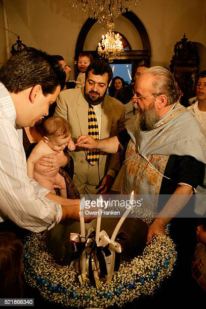 baptism at a greek orthodox church - greek orthodoxy stock pictures, royalty-free photos & images