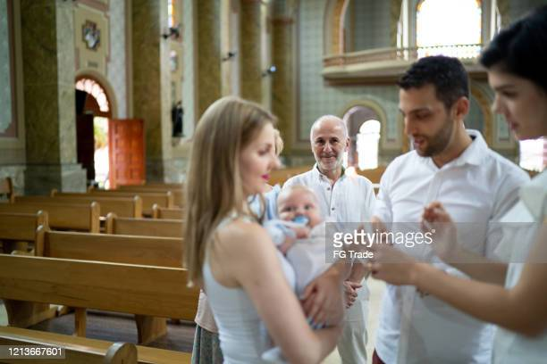 baptism celebration at church - christening gown stock pictures, royalty-free photos & images
