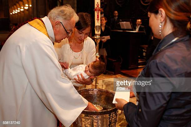 Baptism celebration at Notre Dame de Paris cathedral