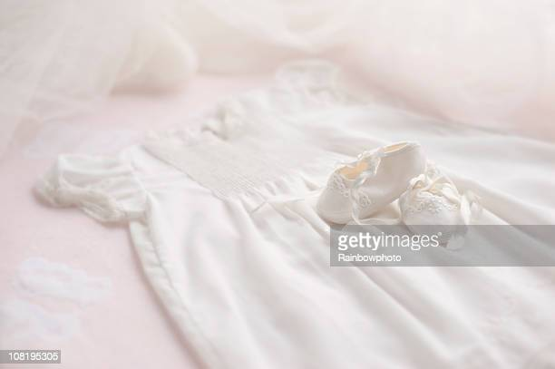 baptism gown with booties & bonnet - satin dress stock photos and pictures