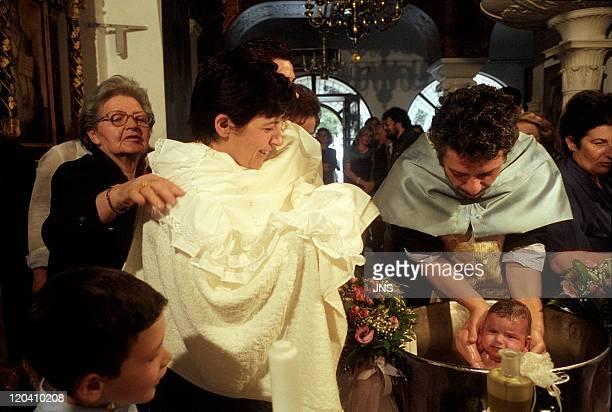 Baptism in Saintecatherine church in Athens Greece in April 2004 Byzantine church