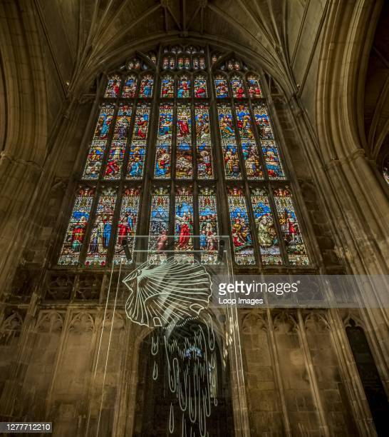 Baptism is a Christian rite of admission to the church as symbolised here in Gloucester Cathedral.