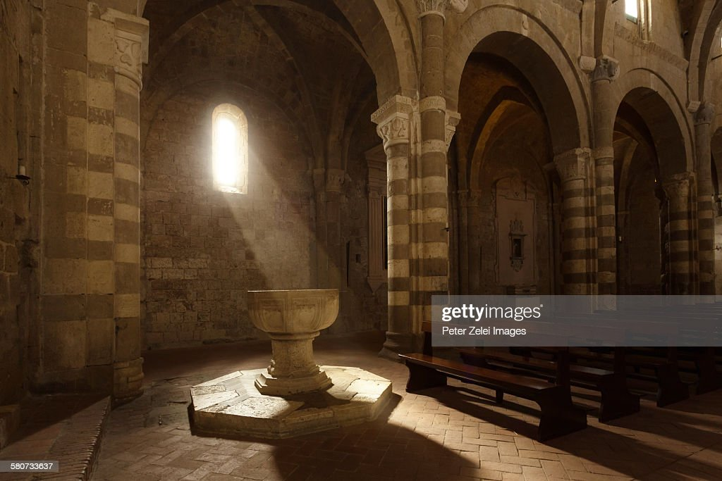 Baptismal font in an ancient cathedral : Stock Photo
