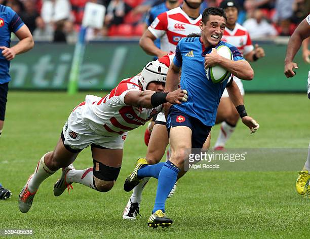 Baptiste Couilloud of France breaks past Tevita Tatafu to score a try during the World Rugby U20 Championship match between France and Japan at AJ...